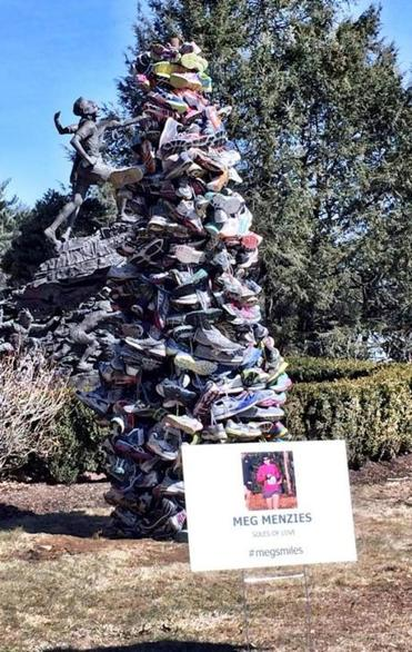 A memorial to Meg Menzies, a Virginia mother who was killed while training for this year's race, was created by Hopkinton resident  Kel Kelly from 400 pairs of running shoes.